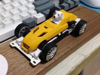 Polar bear in old F1 racer