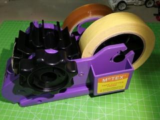 semi-automatic tape dispenser